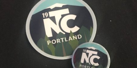 photo of conference branded sticker and button