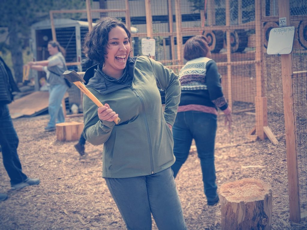 Photo: Eshe has a laugh learning to throw an ax