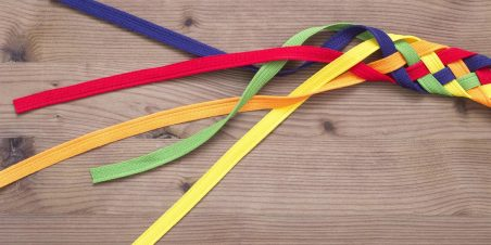 Photo: Multiple strands of different colored fabric interwoven into one larger braid.