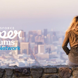 Photo: SuperMums logo with woman looking at a city skyline in the distance.
