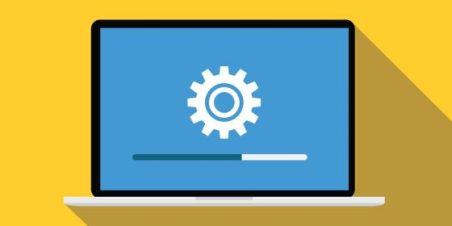 Illustration of a laptop with a gear icon on the screen indicating a software update.