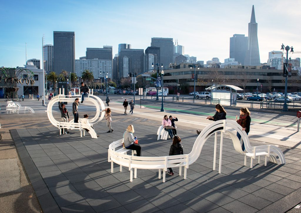 Photo: Exterior outdoor installation at the Exploratorium with the San Francisco skyline in the background.