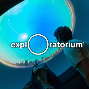 Image: Exploratorium logo with image of visitors looking at an exhibit